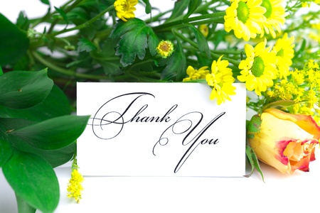 rose, wild flowers and a card signed thank you isolated on white