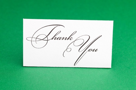 card signed thank you on green background photo
