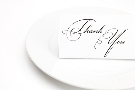 plate with card signed thank you isolated on white photo