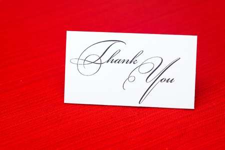 card signed  thank you on a red background photo