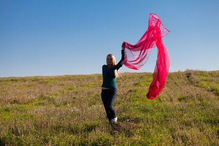 young beautiful woman jumping with tissue into the field against the sky Stock Photo - 9527703