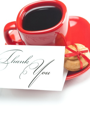 cup with coffee ,thank you card,cake nut and ribbon isolated on white Stock Photo - 9622078