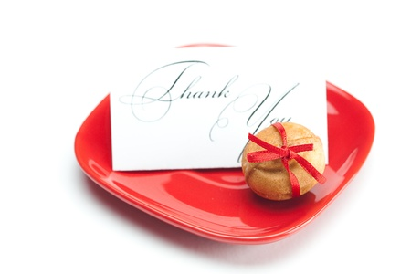 thank you card,cake nut and ribbon isolated on white Stock Photo - 9582480