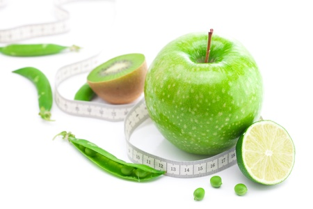 tapeline: apple,lime,peas,kiwi and measure tape isolated on white