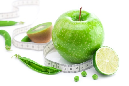 apple,lime,peas,kiwi and measure tape isolated on white photo