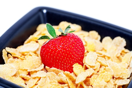 strawberry and flakes in a bowl isolated on white photo