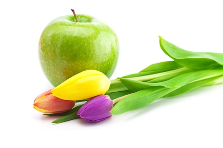 colorful tulips and apple isolated on white Stock Photo - 9662418