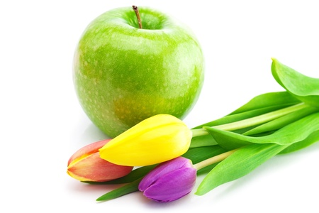 colorful tulips and apple isolated on white photo