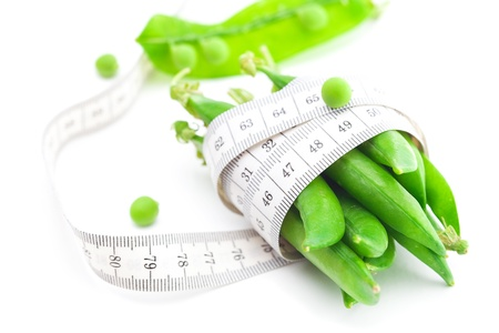 peas and measure tape isolated on white photo