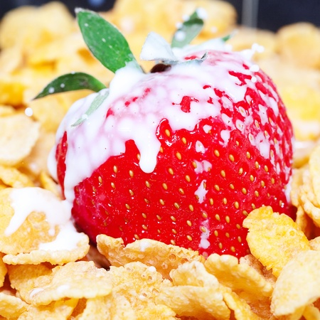 strawberry,milk and flakes in a bowl photo