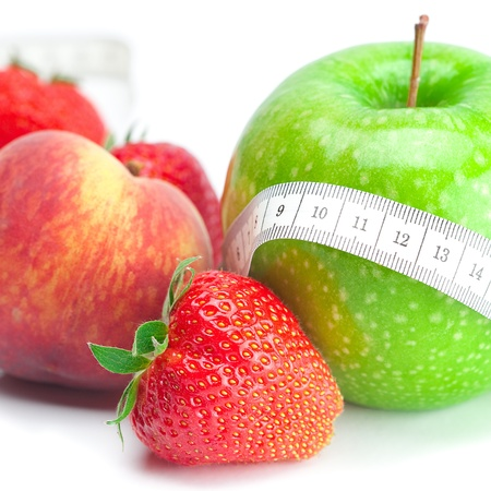 big juicy red ripe strawberries,apple,peas,peach and measure tape isolated on white Stock Photo - 9737312