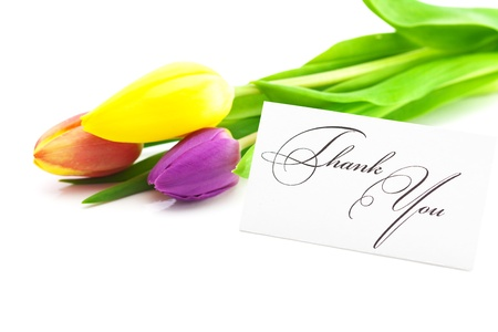 reserved sign: colorful tulips and a card signed thank you isolated on white