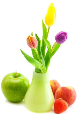 colorful tulips in vase,strawberries,apple and peach isolated on white Stock Photo - 9737213