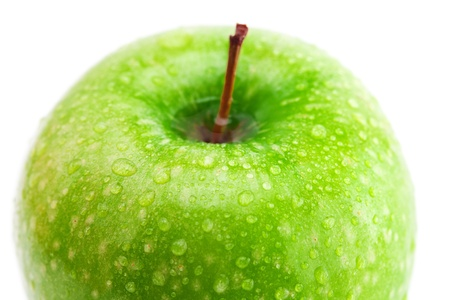 big green apple with water drops isolated on white photo