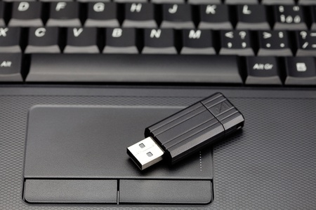laptop keyboard and flash drive photo