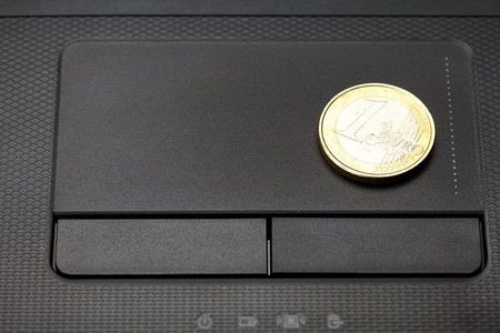 laptop keyboard and coin euro photo