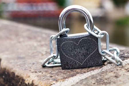 padlock and chain on the parapet Stock Photo - 9737732