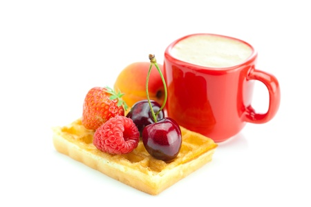 cappuccino cup, waffles,apricot, cherries, strawberries and raspberries isolated on white photo
