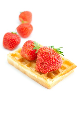 Waffles and strawberries isolated on white photo
