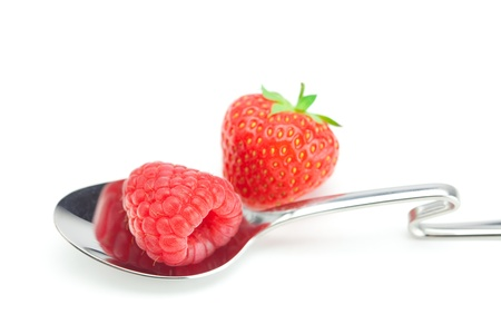 spoon, strawberries and raspberries isolated on white photo