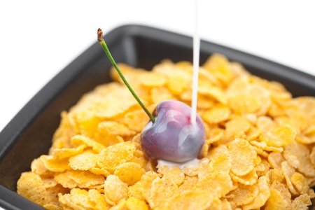 cherry,milk and flakes in a bowl photo