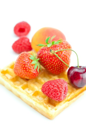waffles, apricot, cherries, strawberries and raspberries isolated on white photo