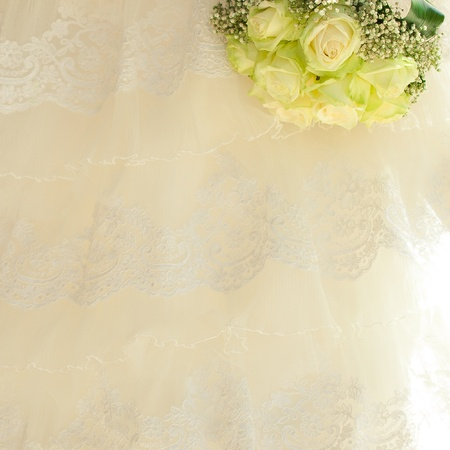 bouquet in the hands of the bride against the background of dress Stock Photo - 9995722