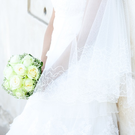 bouquet in the hands of the bride against the background of dress Stock Photo - 9995727