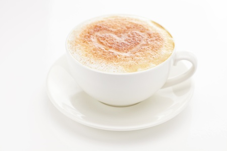 cappuccino in a cup in the shape of hearts isolated on white Stock Photo