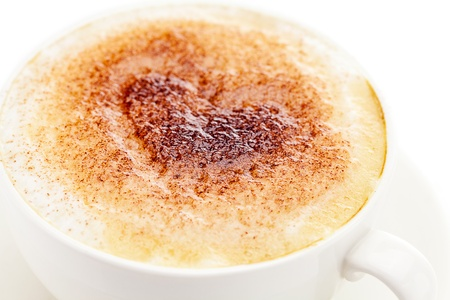 cappuccino in a cup in the shape of hearts isolated on white photo