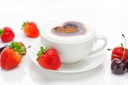 cappuccino in a cup in the shape of hearts,cherry  and strawberries isolated on white Stock Photo - 10617981
