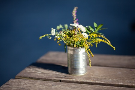 wildflowers in a tin on the table photo