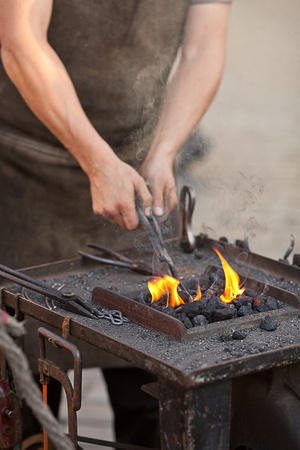 embers, fire, smoke, tools and the hands of a blacksmith Stock Photo - 10694624