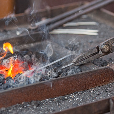embers, fire, smoke and blacksmith tools photo