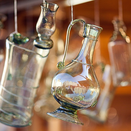 decanters of bohemian glass hanging on hooks
