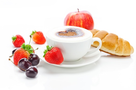 red berries: cappuccino in a cup in the shape of hearts,cherry,apple ,croissant  and strawberries isolated on white