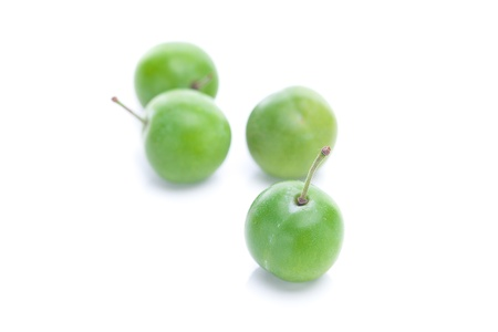 green plum isolated on white Stock Photo - 11712435