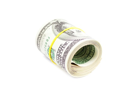 Dollars rolled into a tube tied with an elastic band isolated on white photo