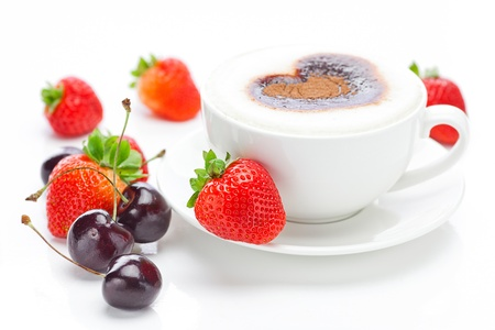 cappuccino in a cup in the shape of hearts,cherry and strawberries isolated on white photo