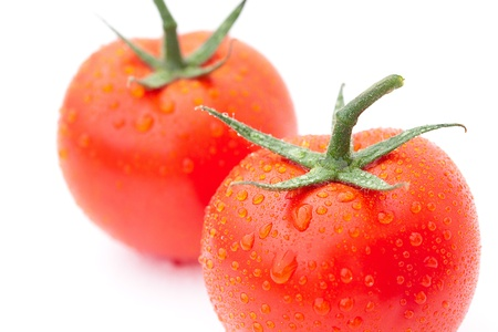 tomato with water drops isolated on white photo
