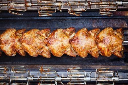 chicken grilled on a skewer background photo