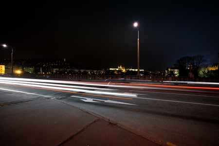 strip of passing cars on the street overnight photo