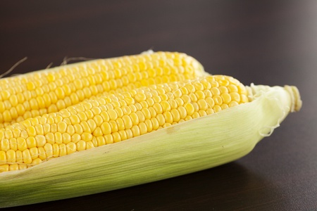 corn lying on a wooden table photo