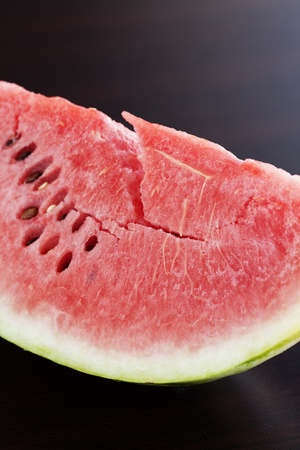 watermelon lying on a wooden table photo