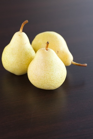 pear lying on a wooden table photo