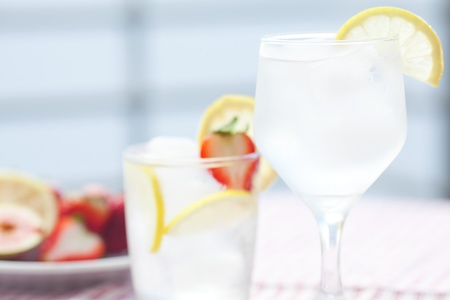 cocktail with ice,lemon, fig and strawberries on a plate Stock Photo - 13640841