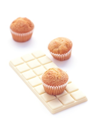 bar of white chocolate and muffin isolated on white Stock Photo - 13639781