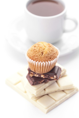 bar of chocolate,tea and muffin isolated on white photo