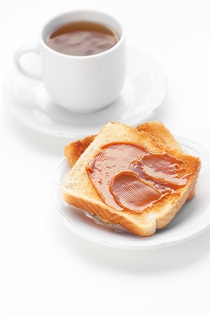 tea and toast with caramel isolated on white Stock Photo - 13646454