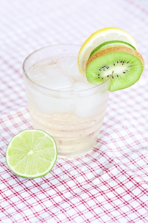 water with lemon and lime,kiwi in a glass with ice photo